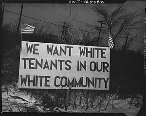 751px-White_sign_racial_hatred.